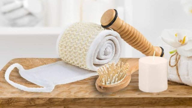 The wooden reflexology stick, massage comb, loofah, candle and eye mask from the Frieda and Joe massage and reflexology kit.