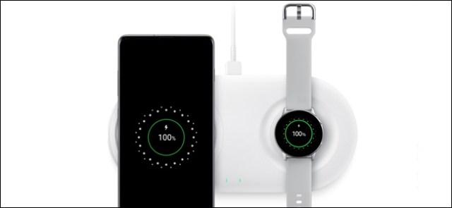 A Samsung phone and a watch on a charger.