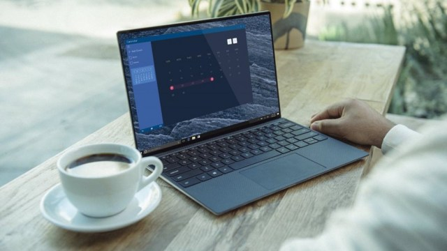 A Dell XPS 13 laptop on a coffee bar.