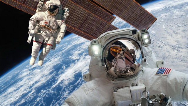 International space station and astronauts in outer space