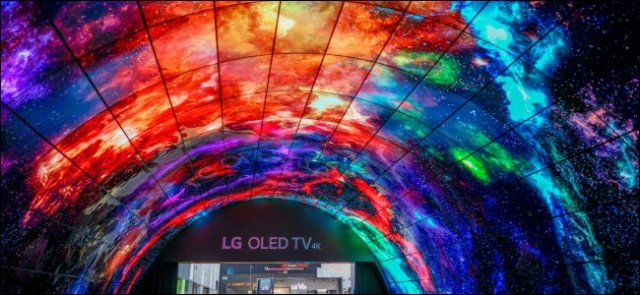 A ceiling display of curved LG OLED TVs.
