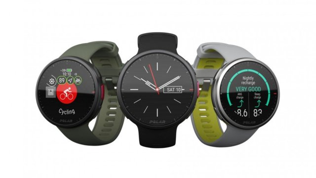 Three Polar fitness watches in gray, black and green.