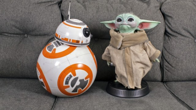 Baby Yoda next to a large BB-8 replica
