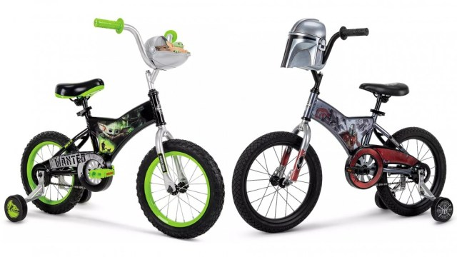 Baby Yoda and Mandalorian bikes face to face on white background