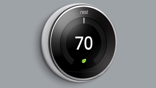 Nest Learning Thermostat, 3rd Generation, mounted on gray wall