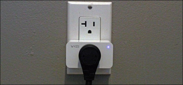 A Wyze plug in an outlet with a plug connected.