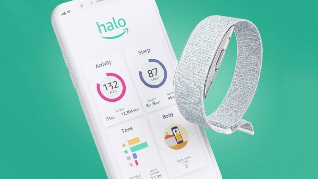 A Halo fitness tracker next to an iPhone with onscreen health stats.