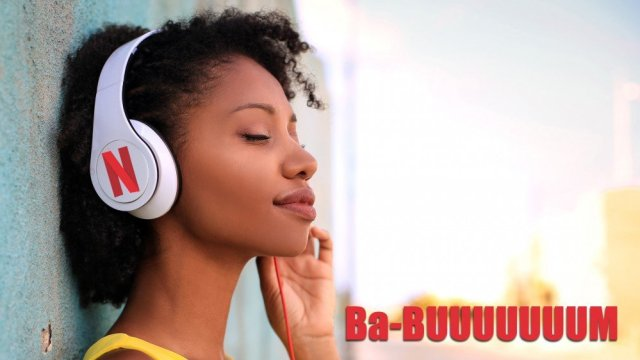 Woman listens to headphones with the Netflix logo