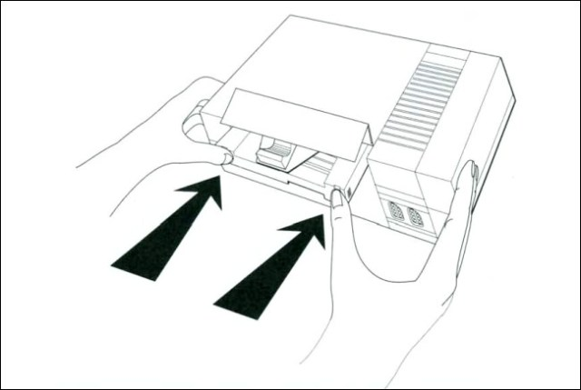 A linear diagram of the insertion of Game Genie in the NES of the Game Genie manual.