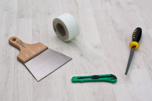 Tools for fixing holes in drywall
