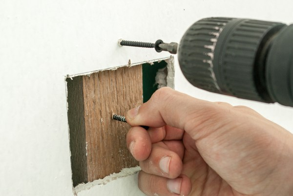 Attaching the backing support to the wall
