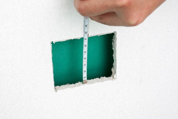 Measuring the hole in drywall