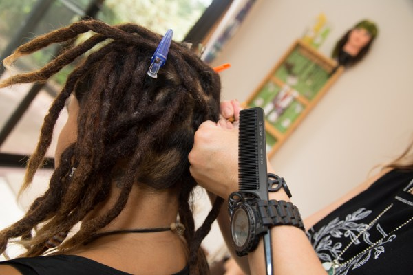 Person getting dreadlocks put in