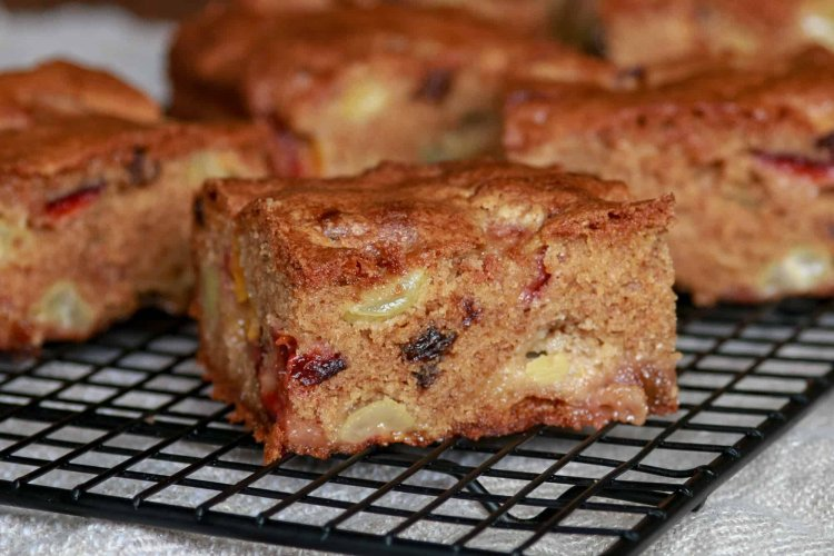 Fresh fruit cake squares with fruit destined for the compost