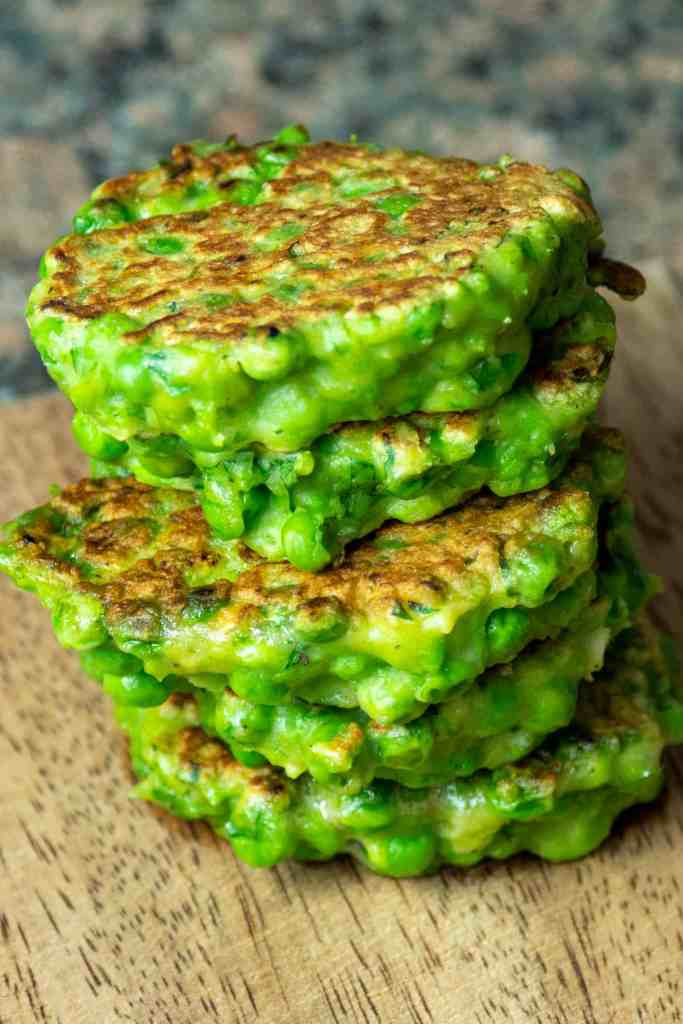 a stack of green pea fritters