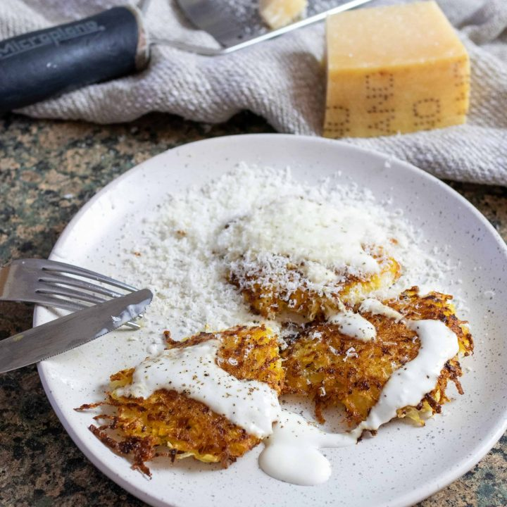 rutabaga latkes with parmesan cheese on a plate