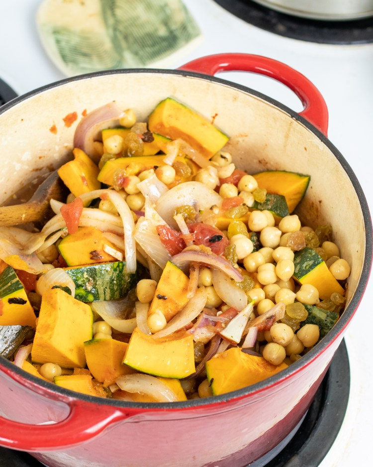 a pot of chickpea and kabocha squash stew, simmering on the stove.