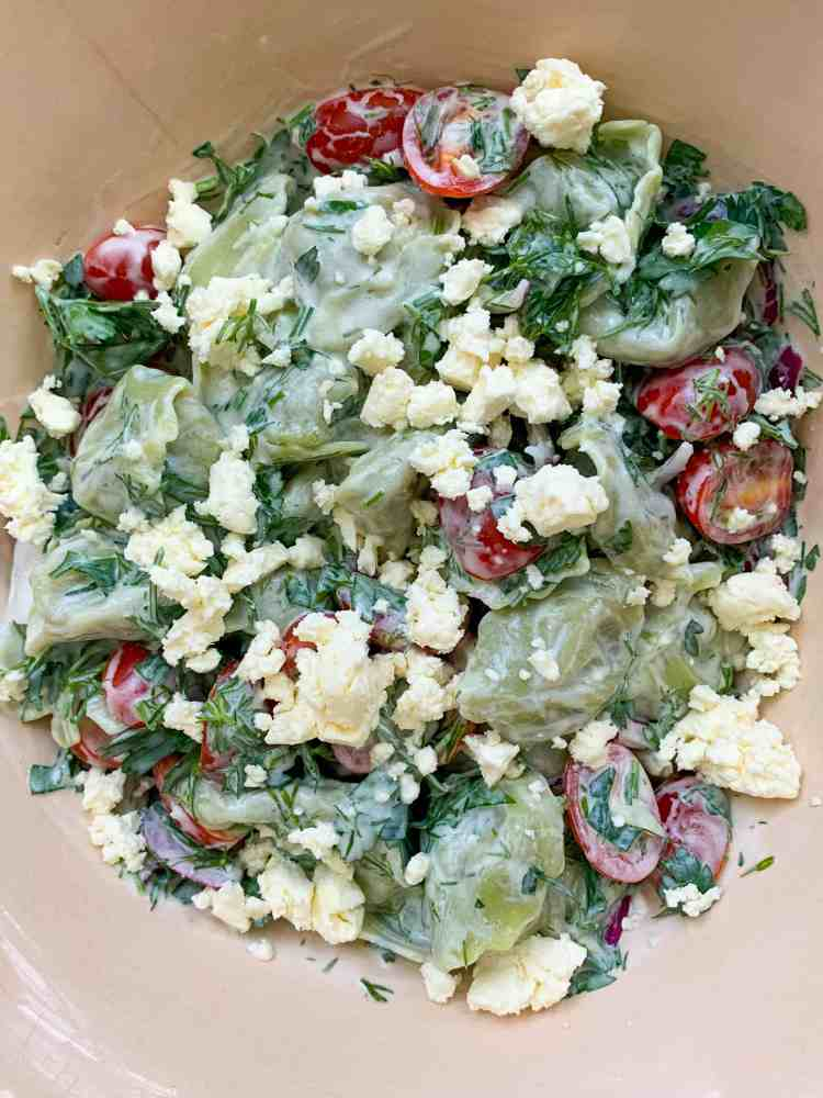 close up of a summer tortellini salad with feta cheese.