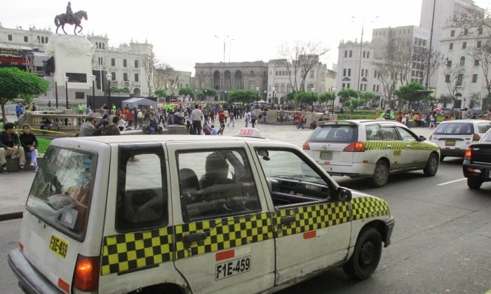 Taxis in Plaza San Martin, Lima.