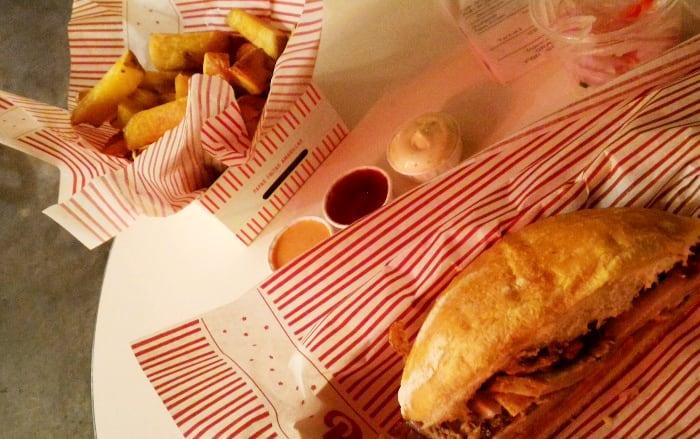 Chicharrón sandwich with fries at República