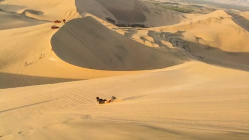 Sandboarding the sand dunes - Peru