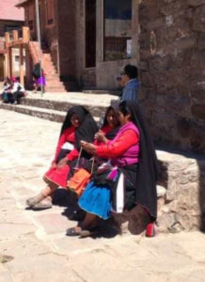 local women sitting in the main square