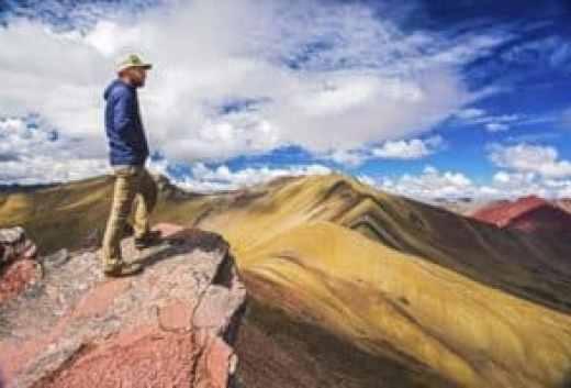 Rainbow Mountain Peru - Man overseeing rainbow mountain
