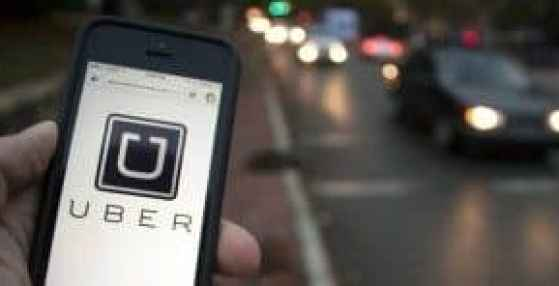 uber logo showing off a phone