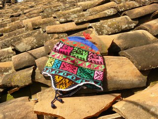 Top peruvian souvenirs - chullo hat with earflaps that has incan patterns on it