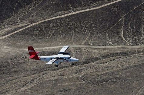 Plane Flying Over Paracas Family Nazca Lines at Pal