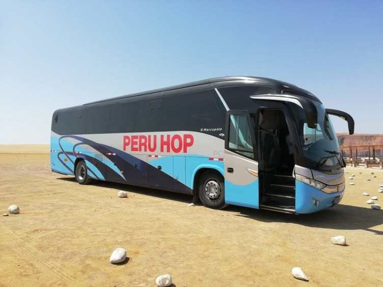 Peru Hop bus to Lake titicaca tours stopped door open sunny day desert paracas