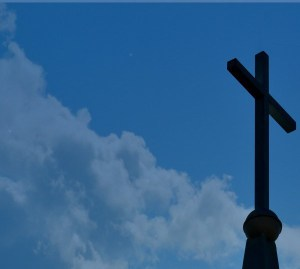 Picture of cross against the clouds taken by Alan Ballou copyright 2019