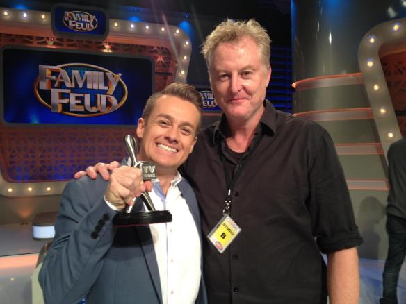 Russell Fletcher and 'Family Feud' host Grant Denyer, with the 2016 Logie award for
