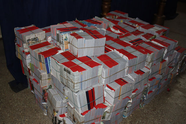 A pile of notebooks for distribution