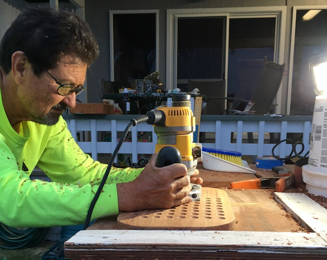 making a konane board drilling the holes with a plunge router