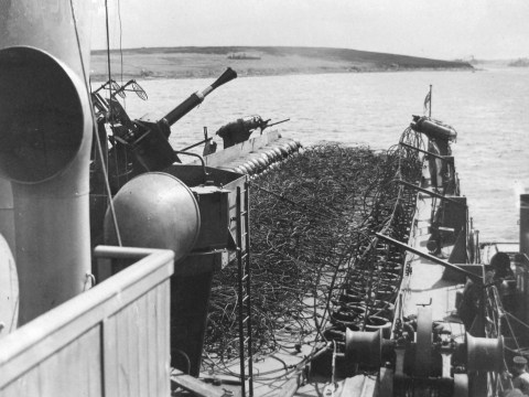 A boom defence netlayer in Gutter Sound © The National Archives, ref. ADM116/5790