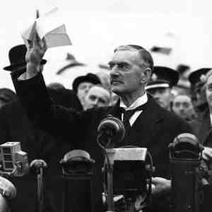 "British PM Neville Chamberlain announces ""Peace in our time"" with noted humanitarian and German leader Adolf Hitler."