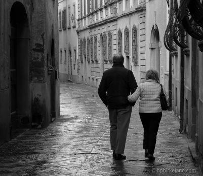 Couple walking in Castiglion Fiorentino, Italy