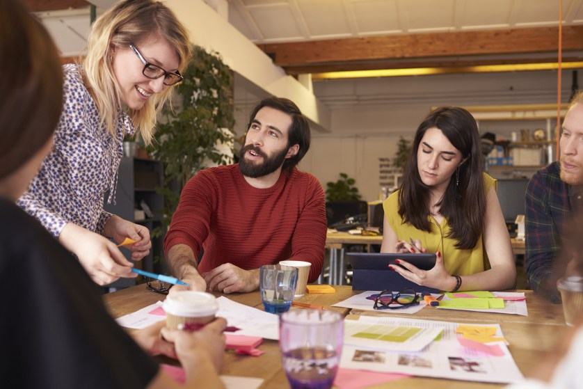 Millennial Female Manager Leads Brainstorming Meeting In Design Office