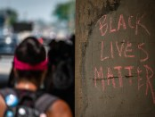 The phrase 'Black Lives Matter' written in red