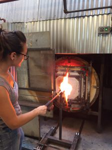 Minhi creating glass sculpture