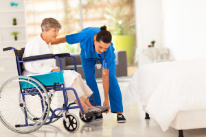 woman in wheelchair in hospital with nurse