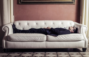 businessman lying on sofa