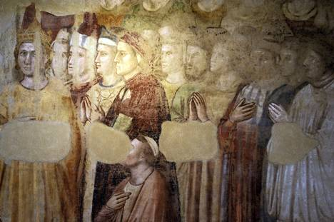 In a fresco by Dante Giotto (in the middle in a red robe) in Florence, Bargello.