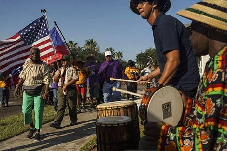 Marching in Galveston, Texas, marched in honor of the feast to the beat of drum accompaniment.