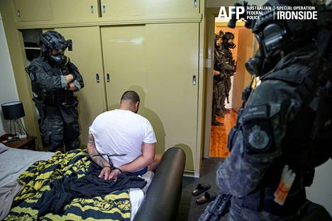 A photo provided by Australian Federal Police of an arrest situation related to the Anom service on Tuesday.