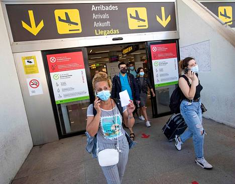 Tourists arrived at Son Sant Joan Airport in Palma de Mallorca in early June.