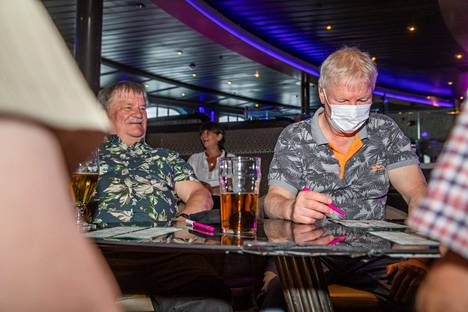 Brothers Topi (left) and Tapani Niiniaro played bingo with a group of friends on Silja Serenade.  The cruise brought a long-needed variation to their daily lives.