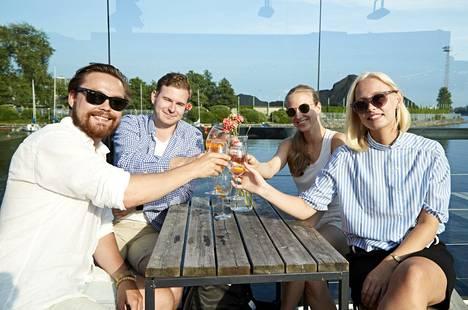 Santeri Huikari, Juhana Kainulainen, Jenna Nyländen and Helmi Lötjönen spend the evening on the terrace of the bar Merikerho.