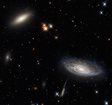 This Hubble image shows galaxies at different stages of development.